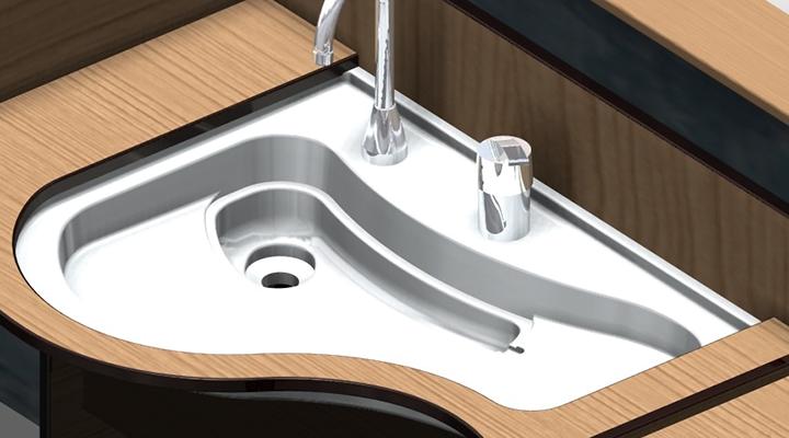 利用者の唾や痰の色は、体の具合をみる大きな指標となります。これを考慮し、シンク内部は白一色を基調としています。 シンク全体がフラットなため、コップなどの道具類をシンク内に置くことが出来ます。